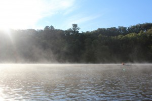 Morning sun, mist, and a kayaker on the St. Croix River