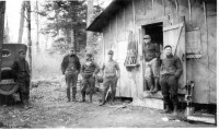 A hunting party at their hunting shack near Cable, Wisconsin (Riegel Historic Collection)